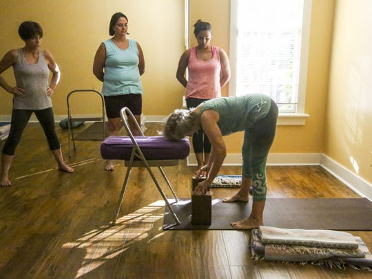 Kandy Love shows her class the first move and how to rest their body on their props.