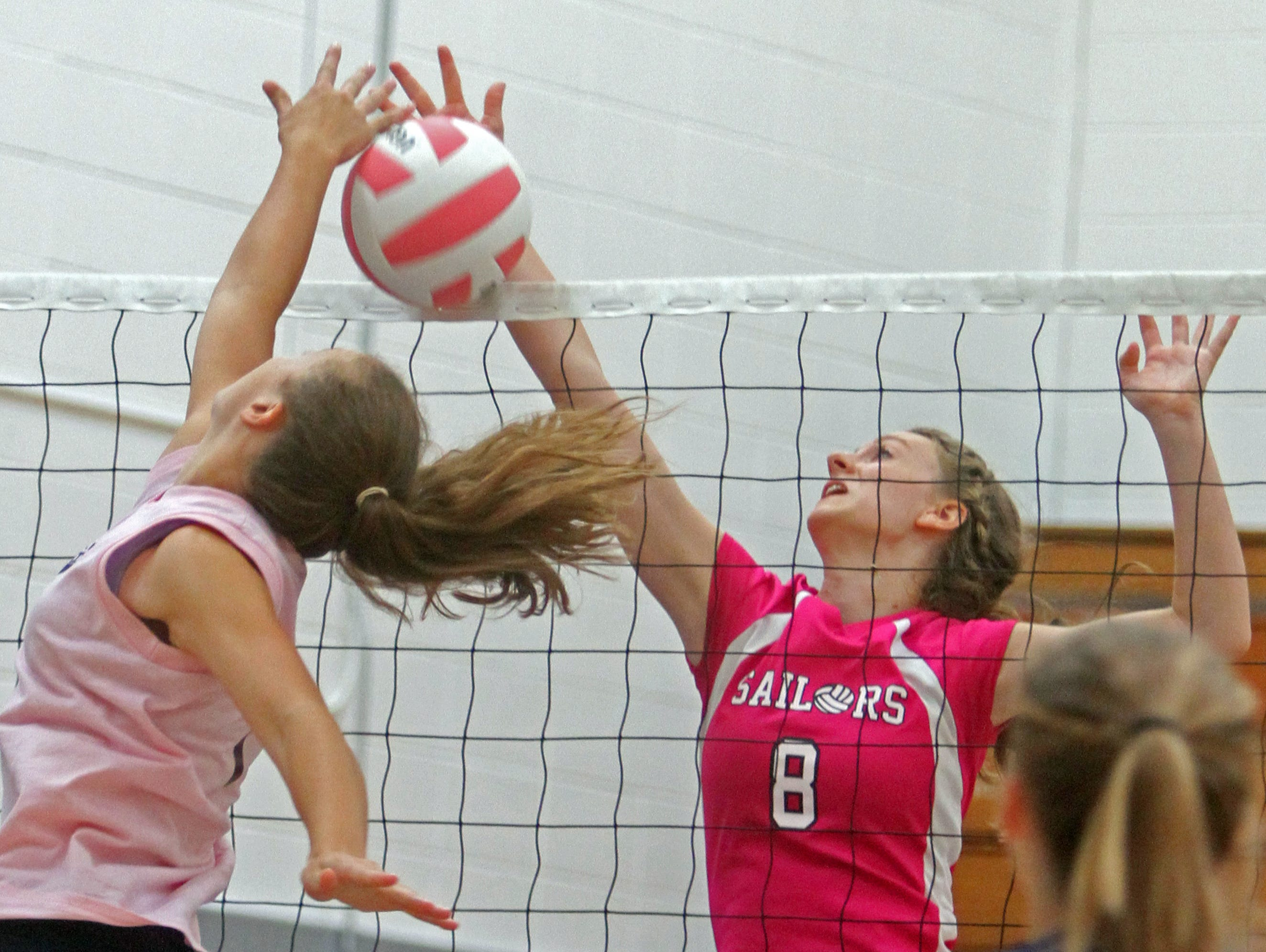 Hendrick Hudson's Gillian Steiglitz battles during a game against Lake George during the annual Breast Cancer Awareness volleyball tournament at Hendrick Hudson High School Sept. 12, 2015.