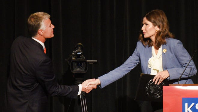 GOP gubernatorial candidates Marty Jackley and Kristi Noem shake hands after the debate in downtown Sioux Falls Thusday, May 31, at the Orpheum Theater. The debate was sponsored by the Sioux Falls Area Chamber of Commerce, The Argus Leader, and KSFY.