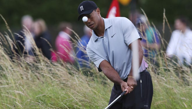 Tiger Woods watches his shot on the practice chipping green ahead of the British Open Golf championship at the Royal Liverpool golf club, Hoylake, England.