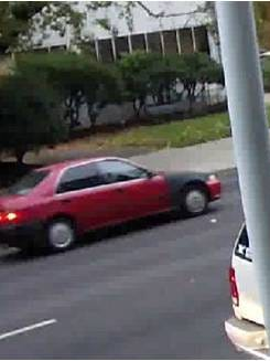 A red car identified by Salem Police as a possible suspect or witness vehicle.