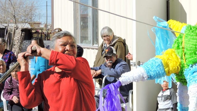 Pinata busting was the highlight of a Christmas Posada for senior citizens in the Mexican border town of Palomas. As many as 30 seniors were treated to music, food and gifts during the celebration provided by Border Partners, the nonprofit humanitarian group along the border.