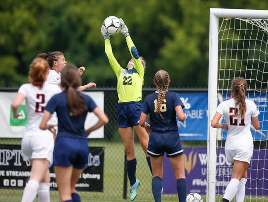 Bishop Heelan goalie Mary Kate Fitzsimmons stops a