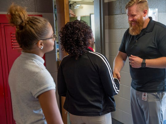 First-year teacher Daniel Tenbarge greets his students