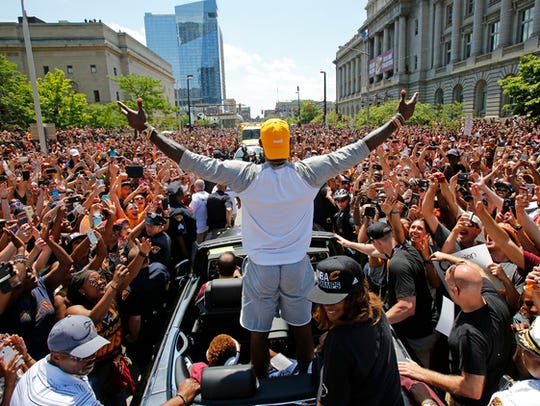 Cleveland Cavaliers' LeBron James, center, stands in