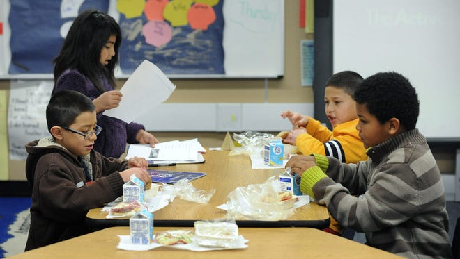 A second grade class has breakfast to start off the day at Corbett Elementary school on March 5, 2013.