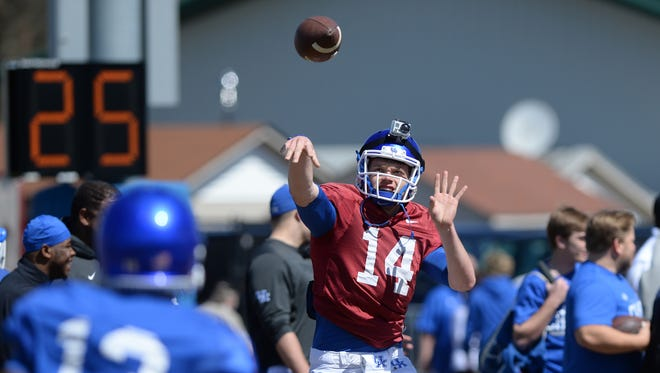 Junior QB Patrick Towles throws a pass to sophomore WR Jeff Badet during the Kentucky football scrimmage on Saturday, April 11, 2015.