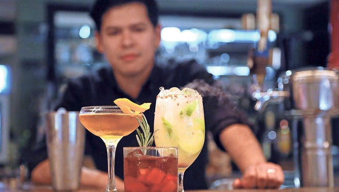Edgar Flores, bar manager at Nose Dive, mixes up some special cocktails for a Halloween date night.