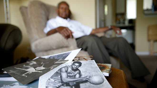 Jumpin'  Johnny Wilson — who won state at Anderson High School, broke records at Anderson College and eventually played for the Harlem Globetrotters — talks about his early sports career  May 25, 2016. A photo of Wilson as a Globetrotter sits on his coffee table inside his Anderson home. Known as an Indiana basketball legend, Wilson is being honored with a nine-foot sculpture at Anderson High School. Wilson is also the oldest living Mr. Basketball.
