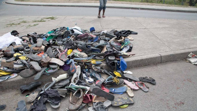 Large number of shoes and slippers are seen at the entrance to the University of Papua New Guinea following a protest rally by the students in Port Moresby on June 8, 2016.
