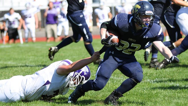 Susquehanna Valley's Kyle Leonard tries to escape the grasp of Norwich's Nick Foster.
