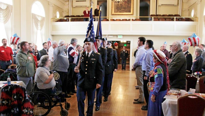 A flag ceremony is conducted Friday, November 10, 2017, during a Veterans Day event at Duncan Hall in Lafayette.