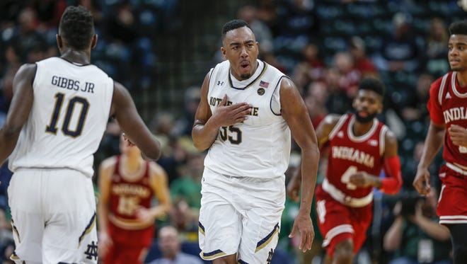 Notre Dame Fighting Irish forward Bonzie Colson (35) past his chest while running back to play defense after making a long jumper against the Indiana Hoosiers during the Crossroads Classic at Bankers Life Fieldhouse in Indianapolis on Saturday, Dec. 16, 2017.