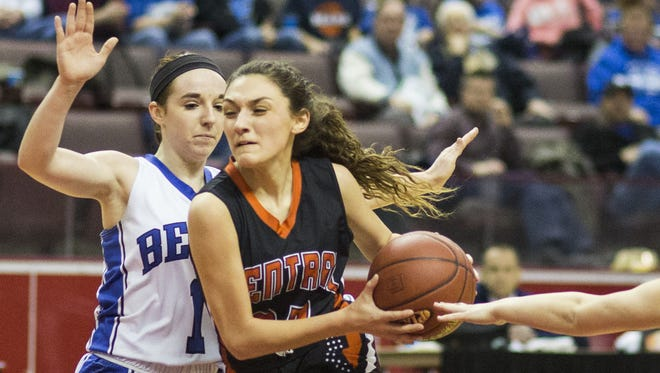Central York's Sarah Sepic, center, drives to the hoop. Central York defeats Elizabethtown 48-37 in a District 3 Class 6A girls' basketball semifinal game at Giant Center in Derry Township, Monday, February 26, 2018.