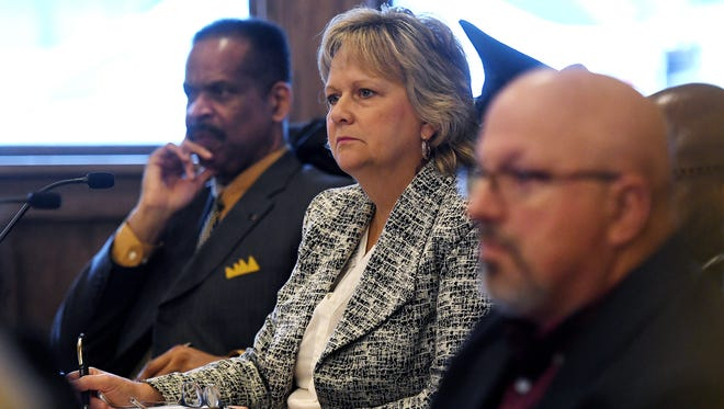 Board of Water and Light Second Ward Commissioner Beth Graham listens to public comment on the proposed $500 million natural gas power during a commissioners meeting at the Board of Water and Light REO Town Depot facility on Tuesday, March 27, 2018, in Lansing.