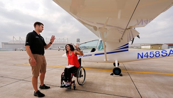 Emily Hupe and flight instructor Austin Decker perform a pre-flight check of a Sky Arrow light sport plane  Tuesday, May 22, 2018, at Purdue Airport. Hupe, who is from Temecula, California, is learning to fly in the Able Flight program.