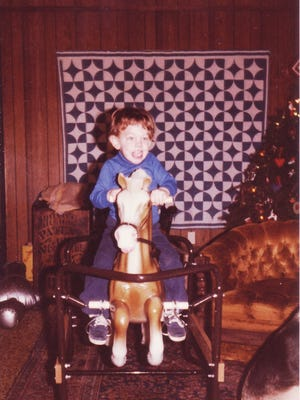 The author's son Greg Oberg, 2 years old in 1979, rides a toy horse in front of the Christmas tree.