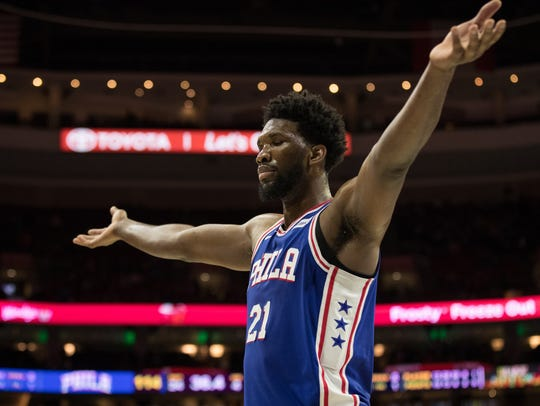 Joel Embiid celebrates as time winds down.