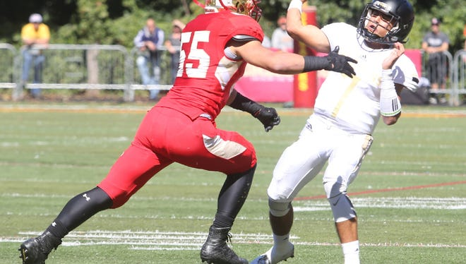 Shqipron Idrizi of Bergen Catholic puts pressure on Paramus Catholic quarterback Andrew Brito when the two teams met in September. Both players were named first-team All-Bergen County.