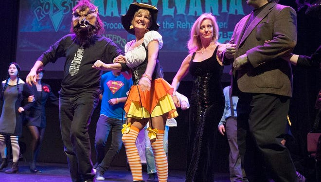 Cast members of the Rehab Town Roast dance their way through their last dress rehearsal Wednesday evening at the Renaissance Theatre. Catch the show at the Renaissance Theatre Friday, October 31st, 2014at 8:00 pm. Lisa Bernheim/News Journal