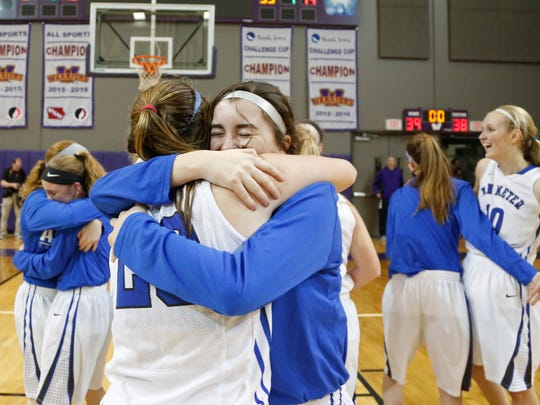 The VanMeter girls' basketball team celebrates after winning the Class 2A girlsÕ regional final basketball game against Panorama on Monday, Feb. 20, 2017, in Waukee. VanMeter won the game 39 to 38 and will advance to the state tournament.
