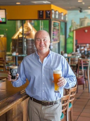 Al Stewart, owner of Stewart's Brewing Company, poses for this 2013 photo. The Bear brewpub turns 20 this year.