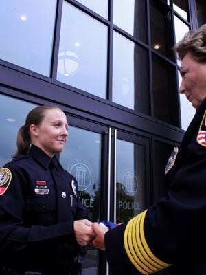 Officer Leigh Ann Hester and Franklin Police Chief Deborah Faulkner at a ceremony marking Hester's return home after a deployment in Afghanistan.