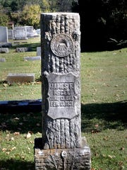 One of the many Woodmen of the World Cemetery markers at the Evergreen Cemetery on Tuesday, Oct. 20, 2015.