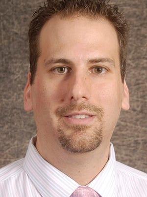 Dr. Michael Colli