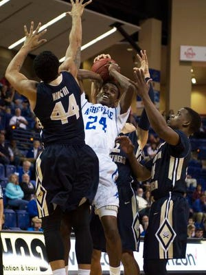 UNCA's Dylan Smith, 24, is swarmed by Charleston Southern' defenders in the first half Wednesday evening at Kimmel Arena.