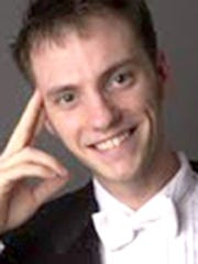 Trent A. Hollinger received his doctor of musical arts degree in wind conducting from the Peabody Conservatory of Music of the Johns Hopkins University.