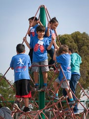Campers form a pyramid Friday at closing ceremonies at Lincoln School in Salinas.