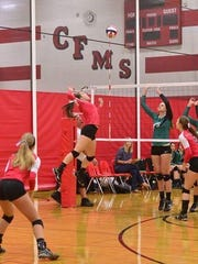 Pacelli senior outside hitter Andrea Pisarski (4) give