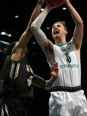 North Dakota center Carson Shanks (5) shoots in front of Idaho forward Brayon Blake (4) during the first half an NCAA college basketball game in the semifinals of the Big Sky tournament in Reno. Nev., Friday, March 10, 2017.