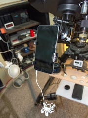 Adapter used to attach iPhone to telescope.