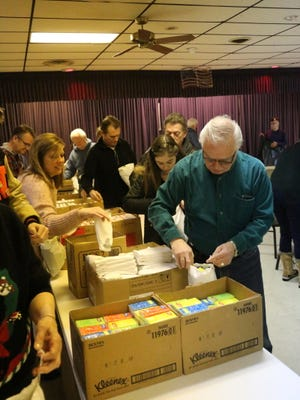 Elks lodge of Plymouth-Ann-Arbor wrapped 880 gifts of 14 items each to be given to America's veterans.