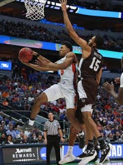 KeVaughn Allen #5 of the Florida Gators goes up for a shot and is blocked by LaDarien Griffin #15 of the St. Bonaventure Bonnies in the first half in the first round of the 2018 NCAA Men's Basketball Tournament at American Airlines Center on March 15, 2018 in Dallas, Texas.  (Photo by Tom Pennington/Getty Images)