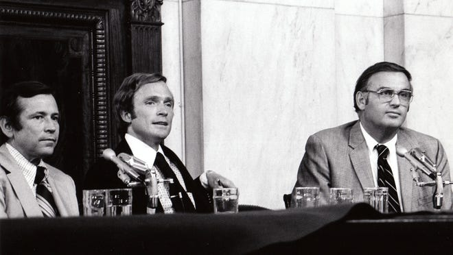 """This Aug. 1, 1973, photo released by PBS shows host Dick Cavett of """"The Dick Cavett Show,"""" center, on location in the Senate Watergate Committee hearing room in Washington with Committee Vice-Chairman, Sen. Howard Baker, left, and Sen. Lowell Weicker. PBS is marking the 40th anniversary of President Richard Nixon's resignation by running a documentary on the Watergate scandal seen through the prism of Cavett's late-night talk show at the time. PBS announced Tuesday, July 1, 2014, it would air Aug. 8 at 9 p.m. EDT — 40 years to the hour after Nixon announced to the nation that he was quitting."""