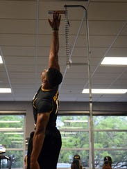 Karen Reed jumps in the vertical exercise during a