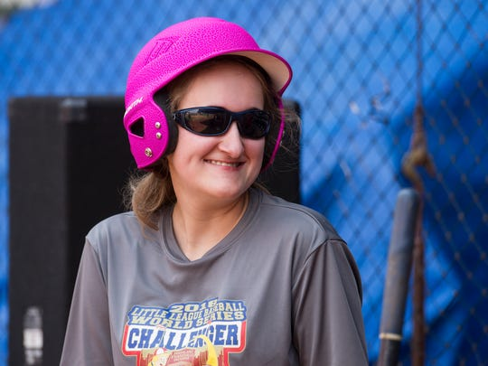 Maddie Barrett smiles before taking the field during the Highland Challenger League fundraiser at Bosse Field to help raise money for a trip to the Little Leauge World Series.