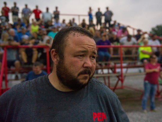 Dusty Knapp is peppered with dust and mud while watching