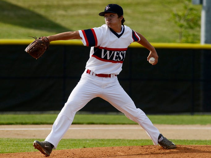 Austin Serck pitches for Post 15 West as they play Post 15 East in Wednesday night's game at Harmodon Park, July 16, 2014.