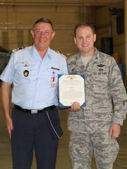 Holloman's 49th Wing Col. Robert Kiebler presented Commanding Director of the German Air Force Flying Training Center Col. Heinz-Josef Ferkinghoff the meritorious medal for all his accomplishments.