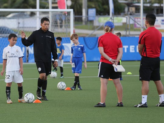 Derrick Cruz conducts an open trial session at the Guam Football Association National Training Center in this file photo.