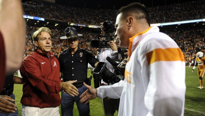 Alabama head coach Nick Saban shakes hands with Tennessee coach Butch Jones after their game at Neyland Stadium in Knoxville on Oct. 25, 2014. Alabama won 34-20.