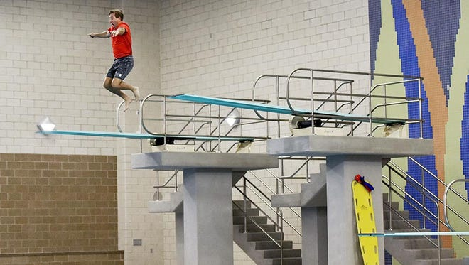 Mayor Mike Huether jumps off the high diving board on the morning of the grand opening of the Midco Aquatic Center on Thursday.