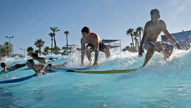Learn the fundamentals of surfing at Big Surf Waterpark in Tempe.
