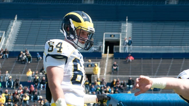 Michigan linebacker Mike Wroblewski warms up for the spring game April 5, 2014.