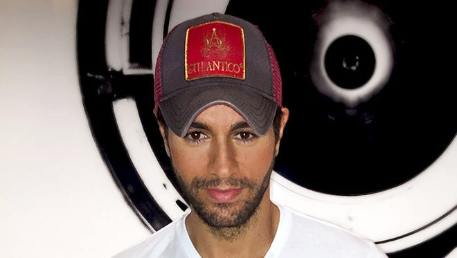 """In this Sept. 30, 2015 photo provided by Enrique Iglesias, Iglesias wears his new """"heart"""" T-shirt in Miami."""