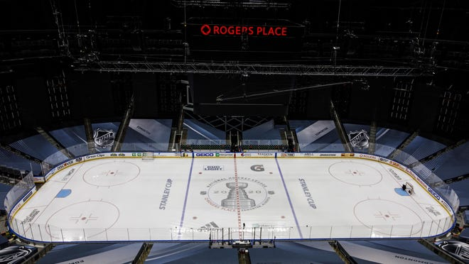 Ice crews work at the NHL playoffs venue in Edmonton, Alberta, Friday, Aug. 28, 2020. Boston Bruins captain Zdeno Chara hopes players and fans take a step back to pause and reflect on racial justice issues as the NHL takes a second day off from second-round series action on Friday, before games resume on Saturday.